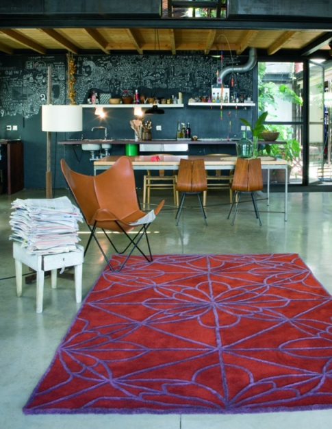 Butterfly chair beside a nanimarquina 'African House' rug.