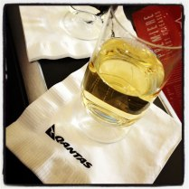Welcome glass of champagne before taking off in Qantas Business Class.