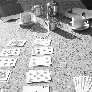 Our morning ritual - a game of two-handed 500.