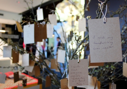 Wishes on a tree at the entrance to KE-ZU's Alexandria retail space.