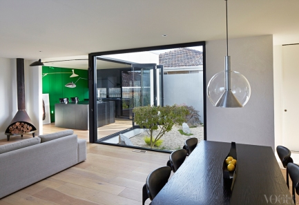 The kitchen and casual dining room of a Melbourne architect from 'Rear Window' on page 208. Photograph by Nils Koening.