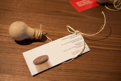 An invitation in the form of a wooden lightbulb